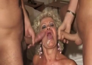 Curly mommy serves two dicks of her relatives