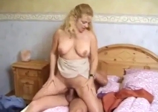 Curly-haired busty sister nicely jumps on her brother