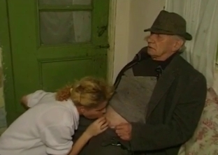 Young granddaughter blows her grandpa's cock