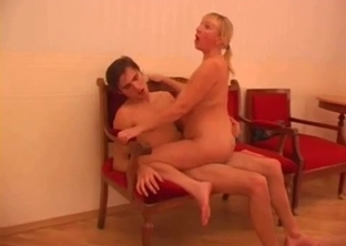 Aunt with saggy boobs enjoys doggy style sex